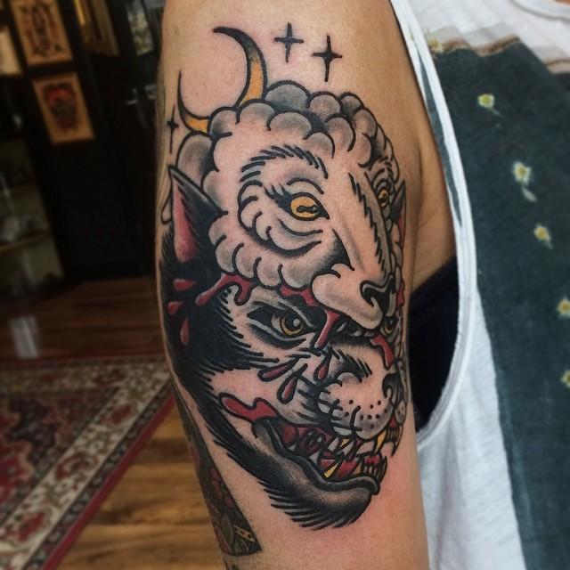 Wolf and sheep tattoo