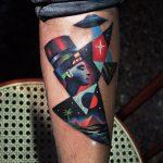 Nefertiti and flying saucer tattoo