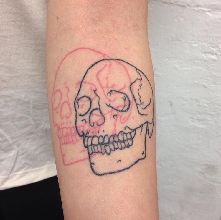 3d pink and black skull tattoo