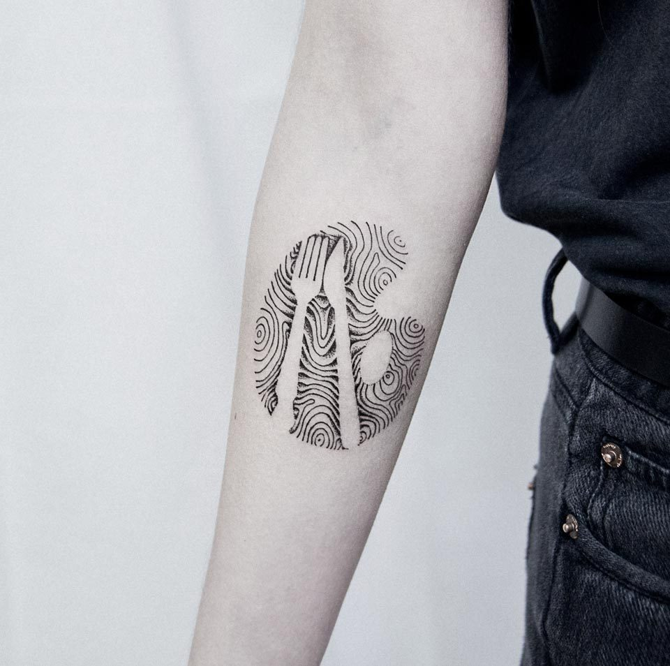 Abstract fork and knife tattoo