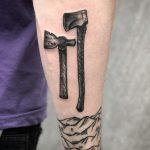 Axes tattoo