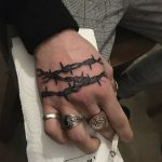 Barbed wire tattoo on the hand