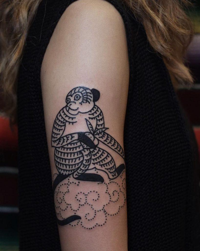 Batik monkey tattoo