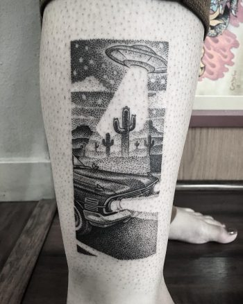 Black and grey alien abduction scenery tattoo