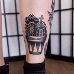 Black and grey cacti in a pot tattoo