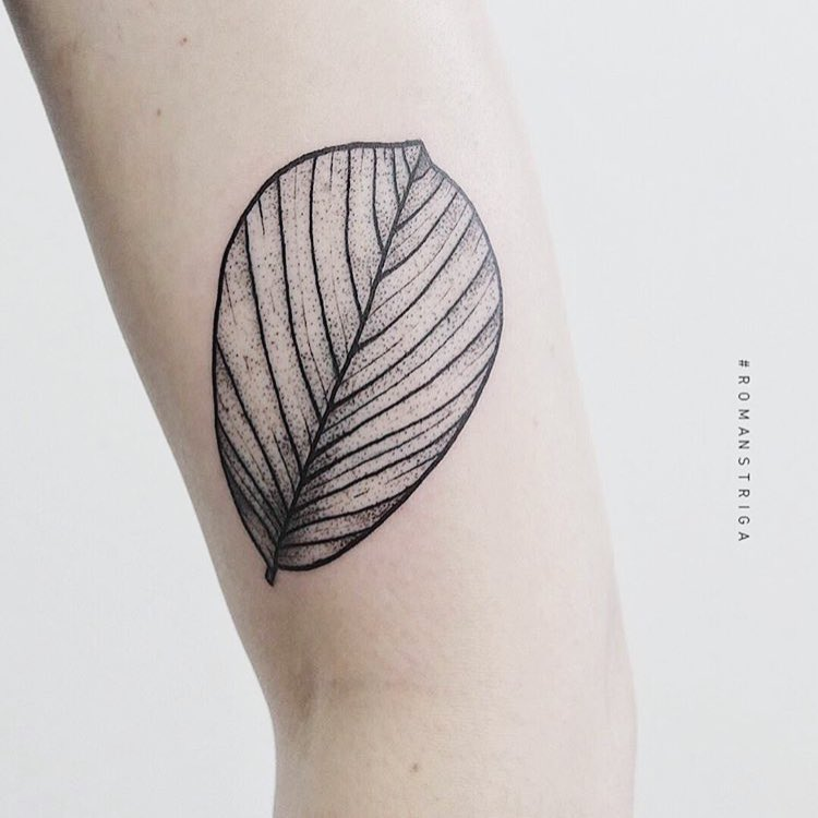 Black and grey leaf tattoo