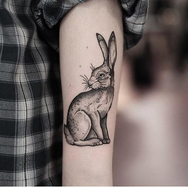 Black and grey rabbit tattoo by jonas
