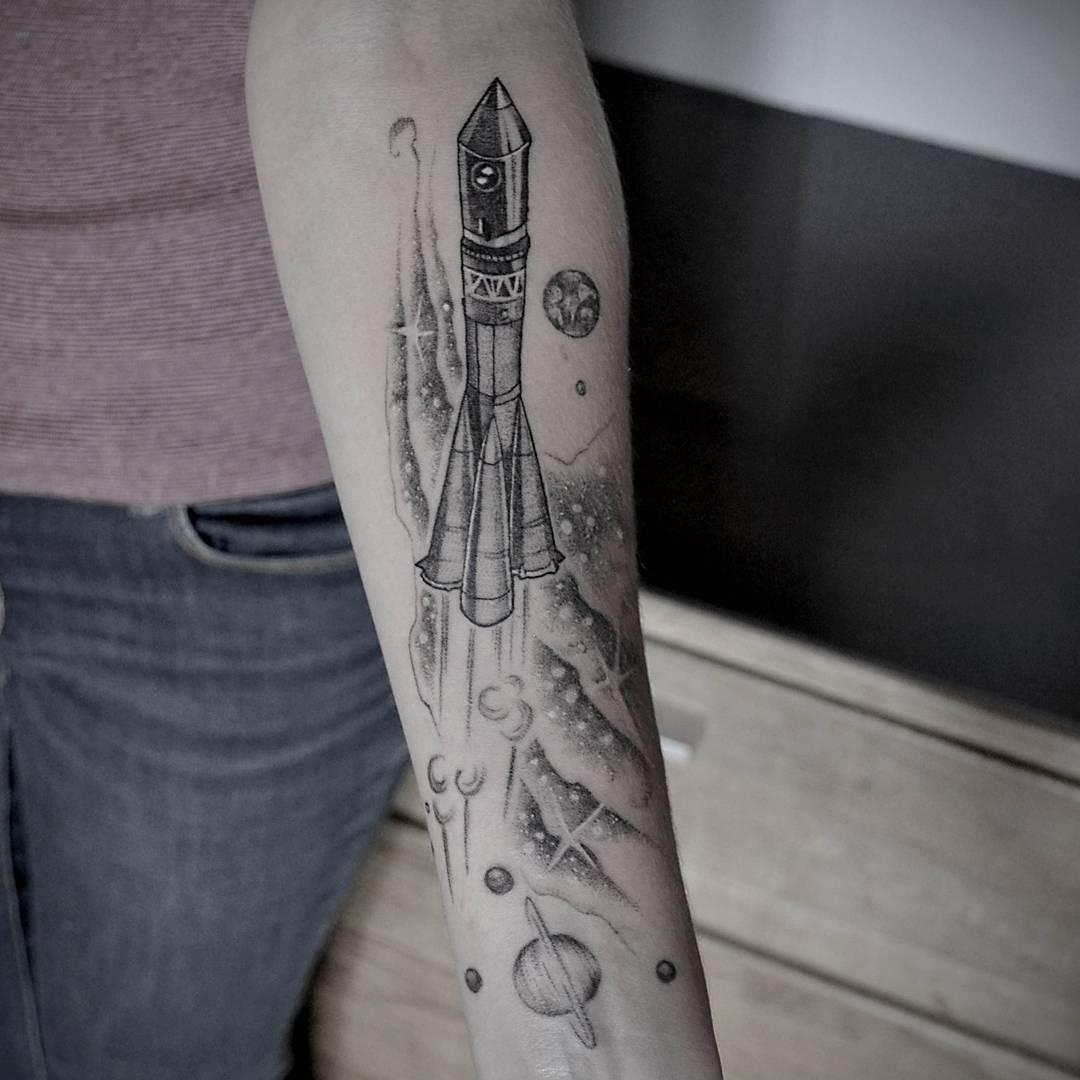 Black and grey rocket tattoo