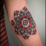 Black and red mandala tattoo by bastien jean