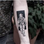 Black and white astronaut tattoo