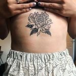 Black and white peonny tattoo on the belly