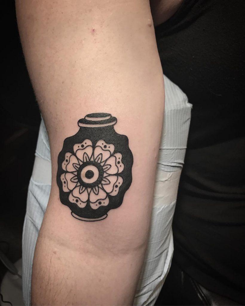 Black and white vase tattoo