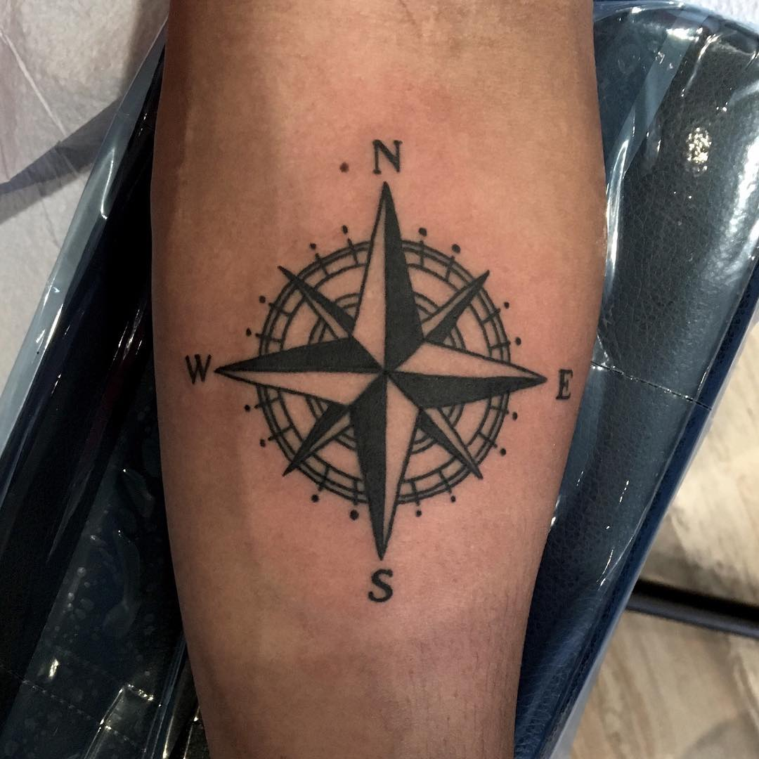 Black compass rose tattoo