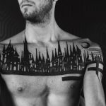 Black medieval city landscape tattoo