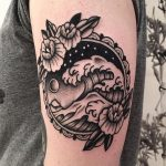 Black ocean wave tattoo