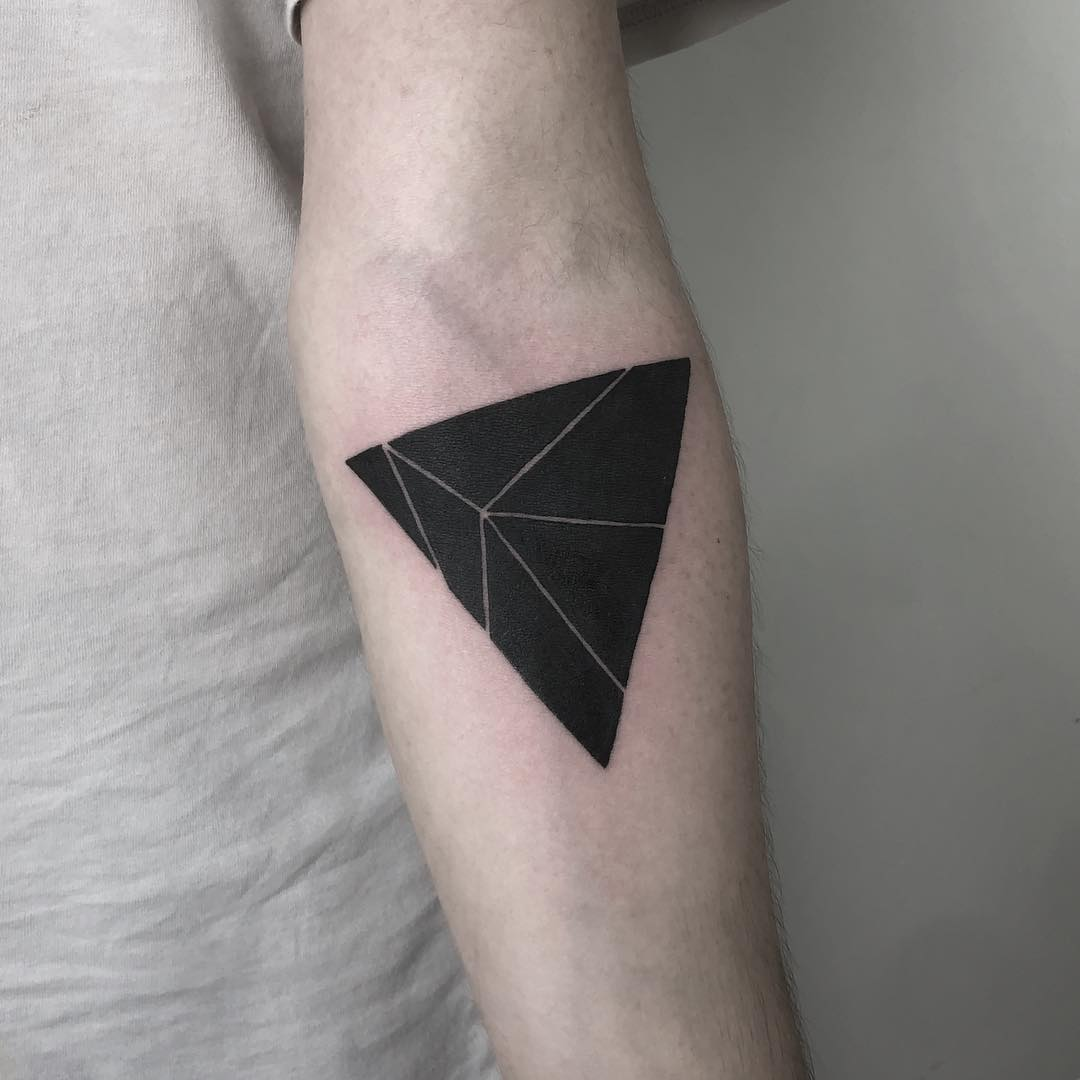 Black triangle with white lines tattoo
