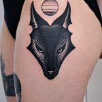 Black wolf head tattoo