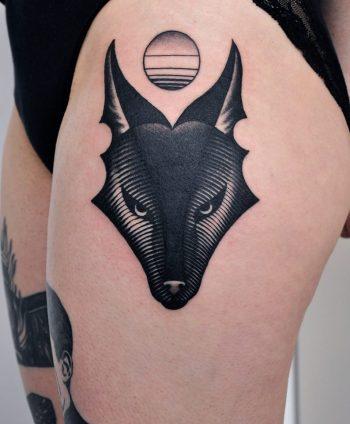 Black wolf head tattoo