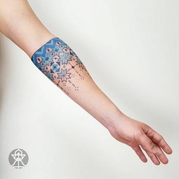 Blue pattern tattoo on the forearm
