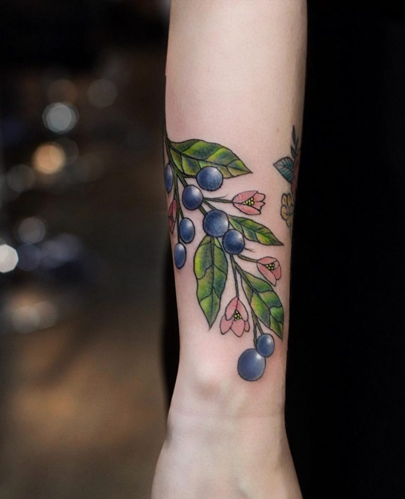 Blueberries tattoo on the wrist