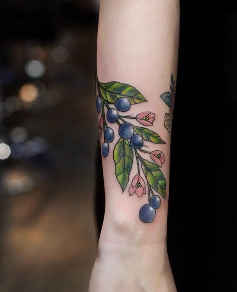 Blueberries tattoo on the wrist