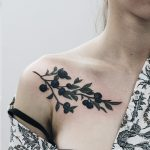 Blueberry tattoo on the collarbone
