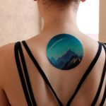 Blueish landscape tattoo