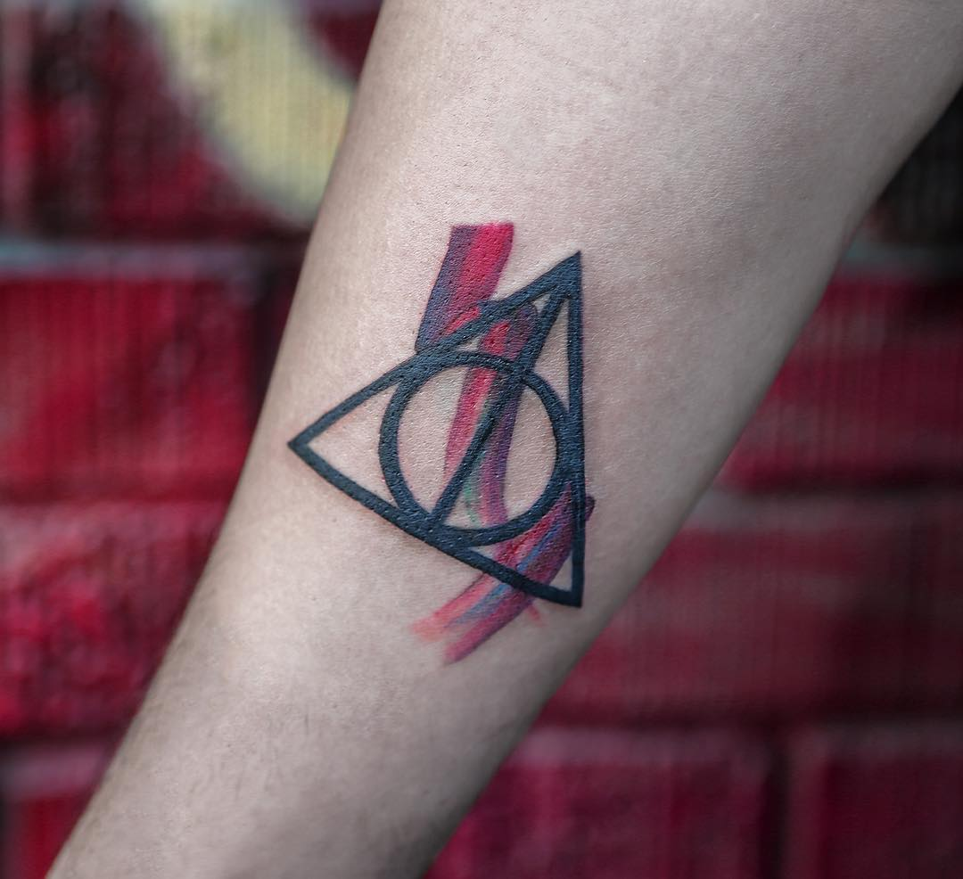 Colorful deathly hallows tattoo