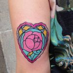 Colorful heart shaped rose tattoo