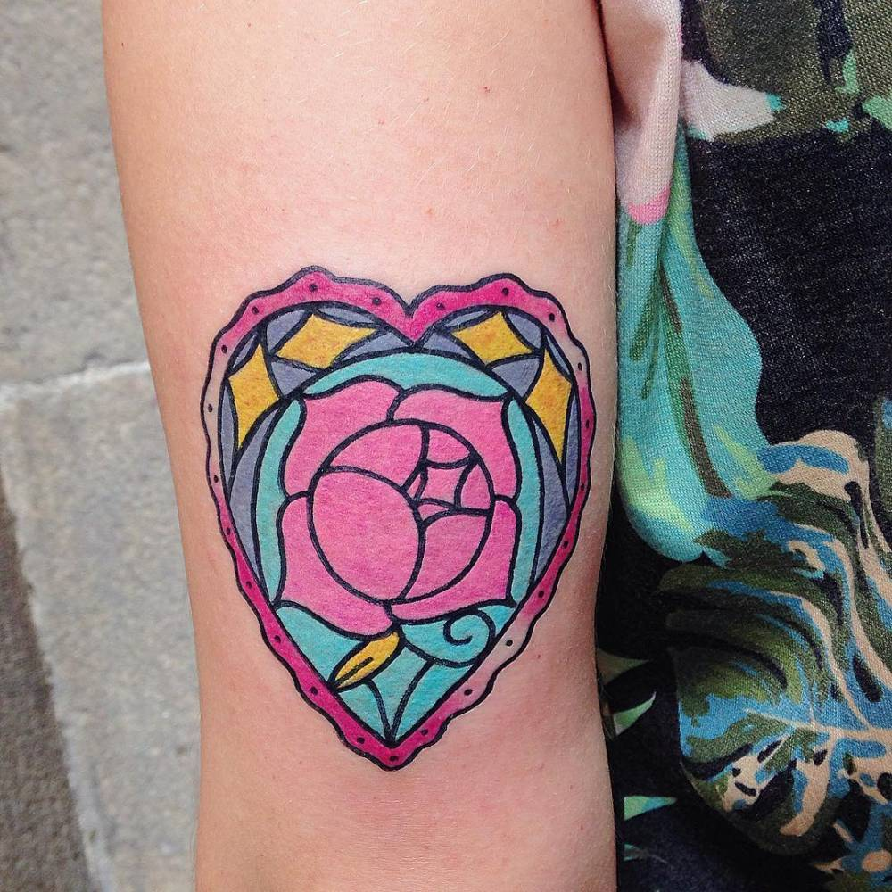 Colorful heart shaped rose tattoo