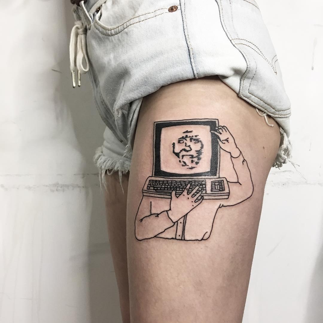 Computer head tattoo