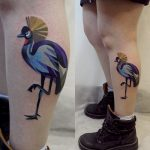 Crowned crane tattoo on the calf