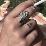 Deathly hallows tattoo on a finger