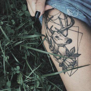 Deer and flowers tattoo