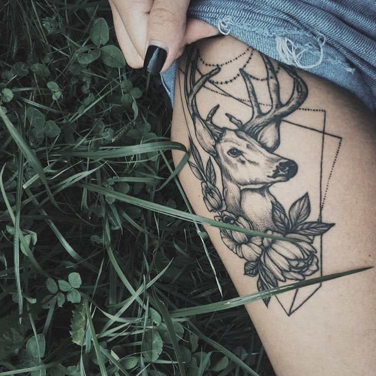 Deer and flowers tattoo