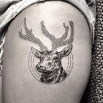 Deer with linear antlers tattoo
