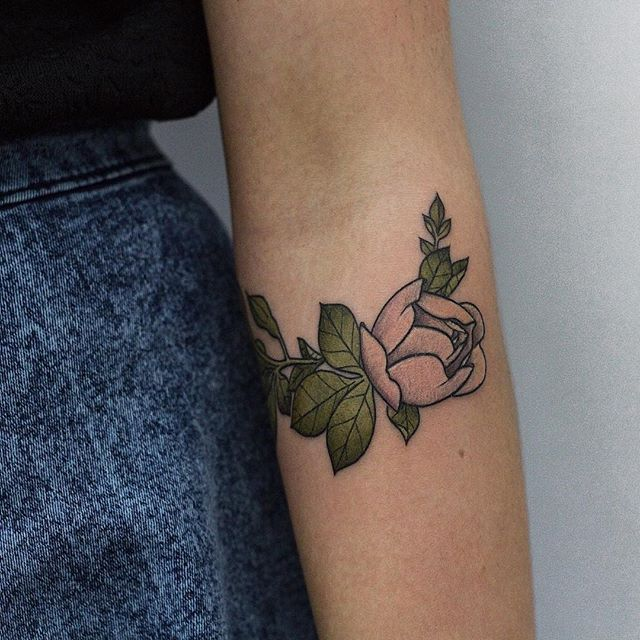 Delicate pink rose tattoo on the arm