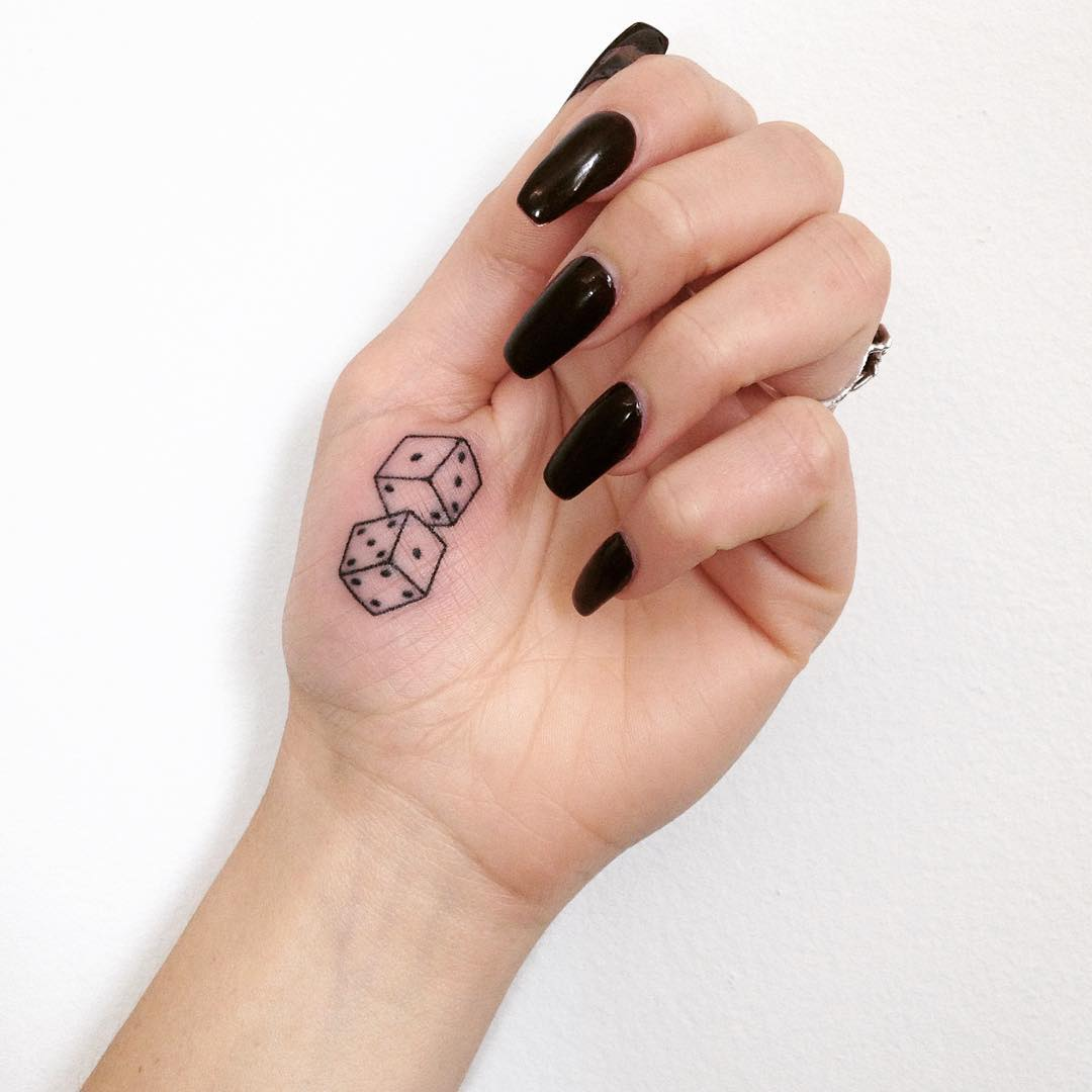 Dices tattoo on the palm