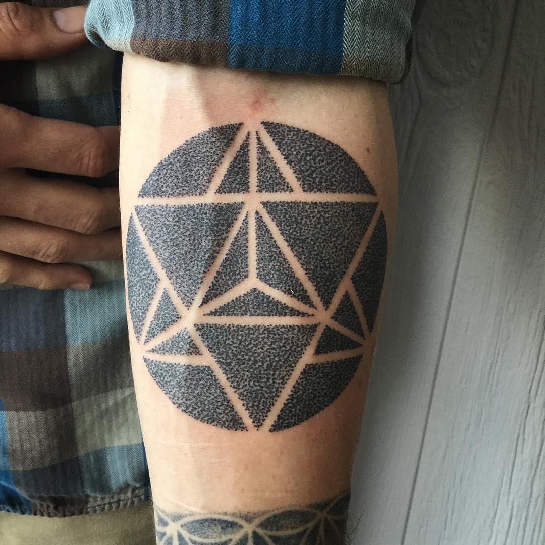 Dot work style sacred geometry tattoo