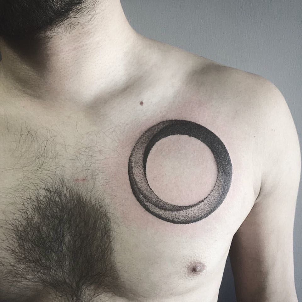 Dotwork circle tattoo on the chest