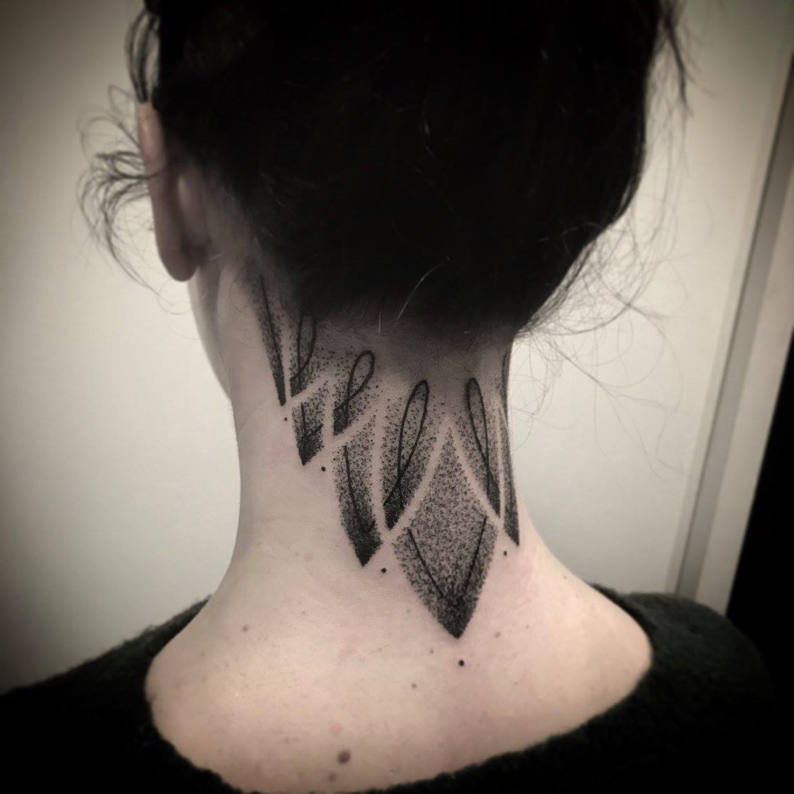 Dotwork ornament tattoo on the neck