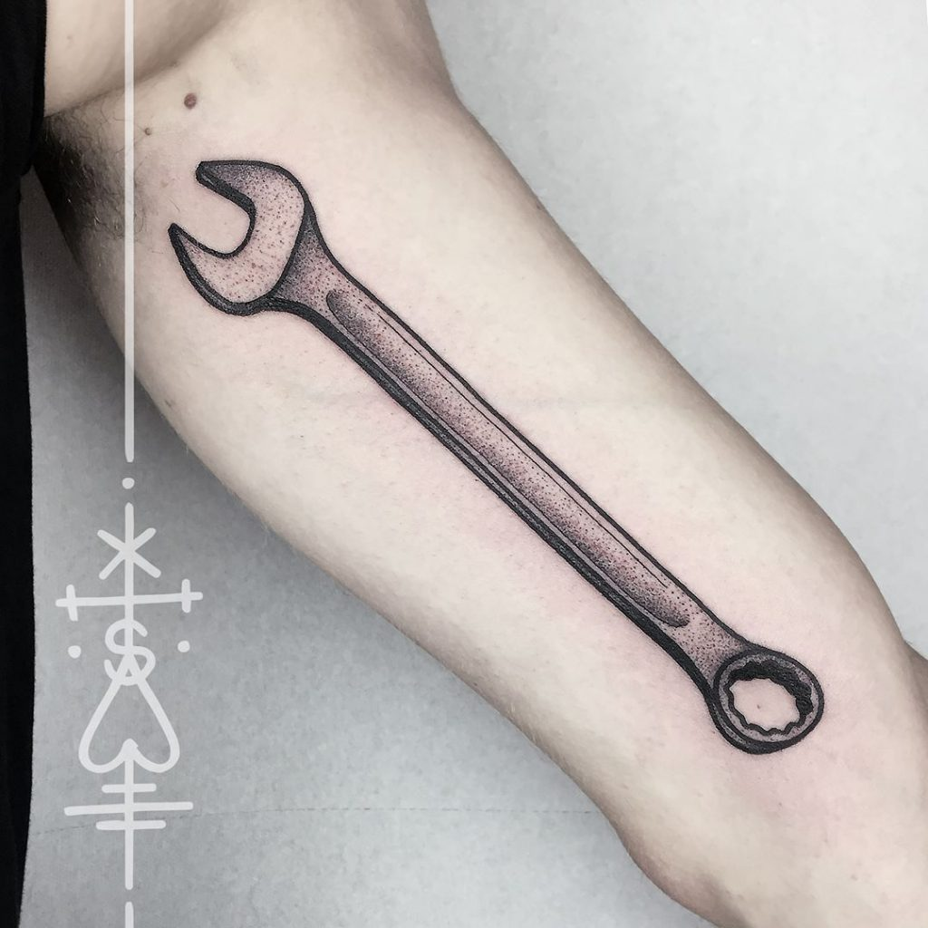Dotwork wrench tattoo