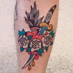 Flaming heart and dagger tattoo