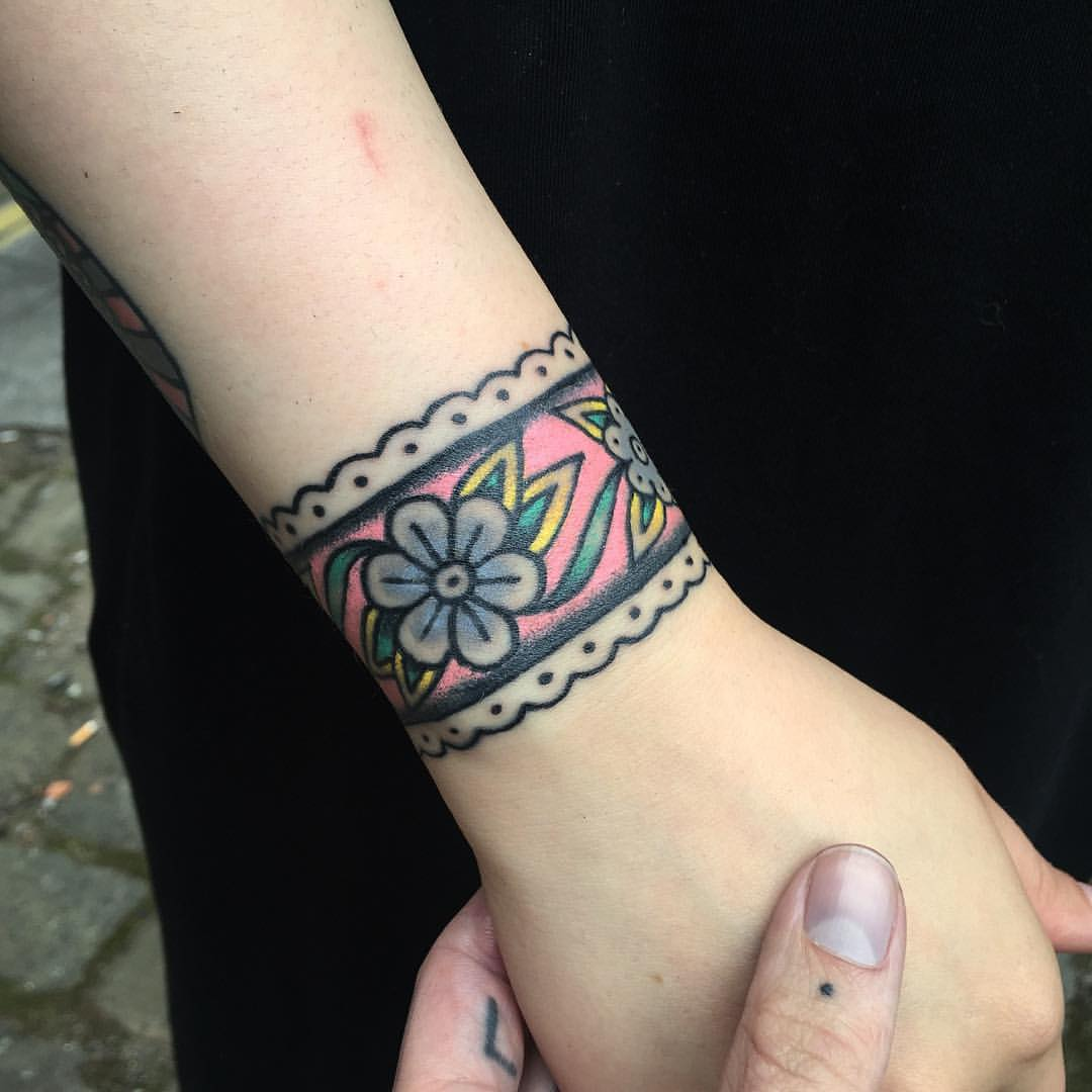 Floral wristband tattoo on the wrist