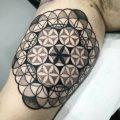 Flower of life tattoo on the right bicep
