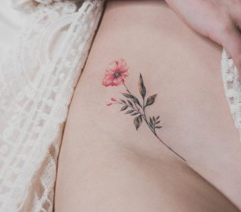 Flower tattoo on the right hip