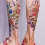 Flower tattoos on both calves