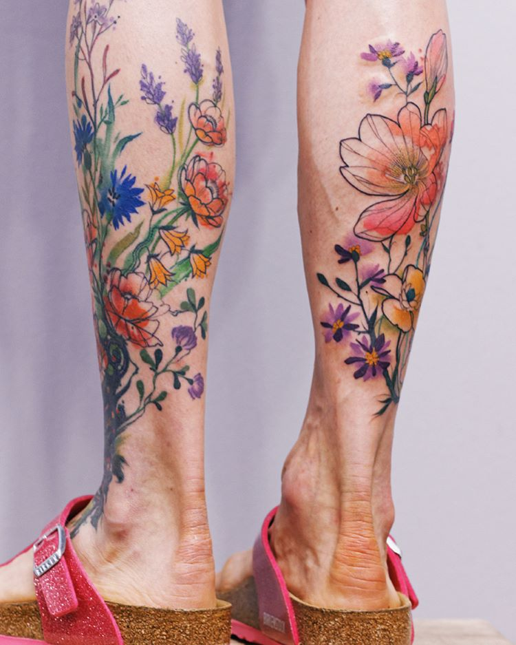 Flower tattoos on both calves