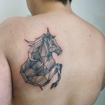 Geometric linear horse tattoo
