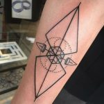 Geometric weather vane tattoo